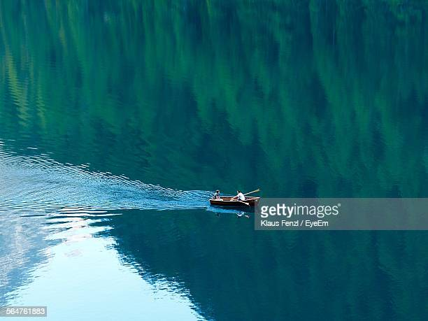 high angle view of person boating in sea - bateau à rames photos et images de collection
