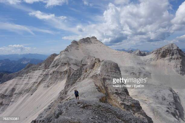 High Angle View Of Person Climbing On Mountain Against Cloudy Sky At Karwendel