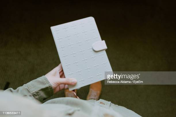High Angle View Of Person Holding Diary