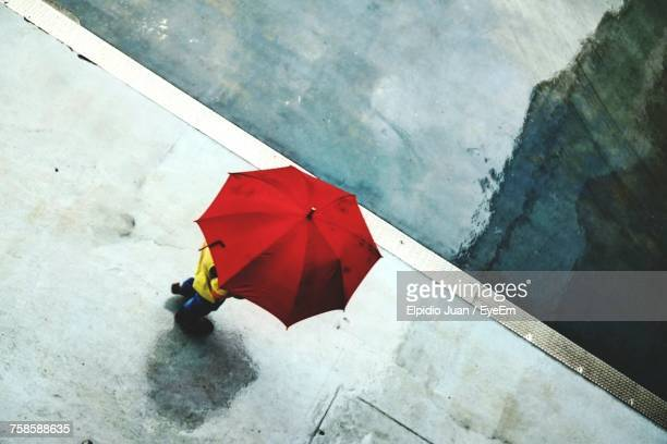 High Angle View Of Person Holding Umbrella