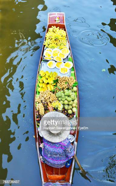 high angle view of person in boat at floating market - floating market stock pictures, royalty-free photos & images