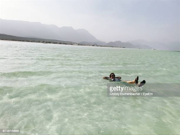 high angle view of person swimming in lake against clear sky - djibouti stock pictures, royalty-free photos & images