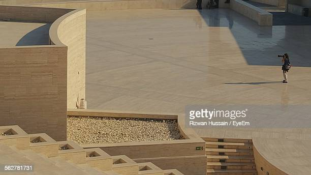 high angle view of person taking picture of building - qatar stock pictures, royalty-free photos & images