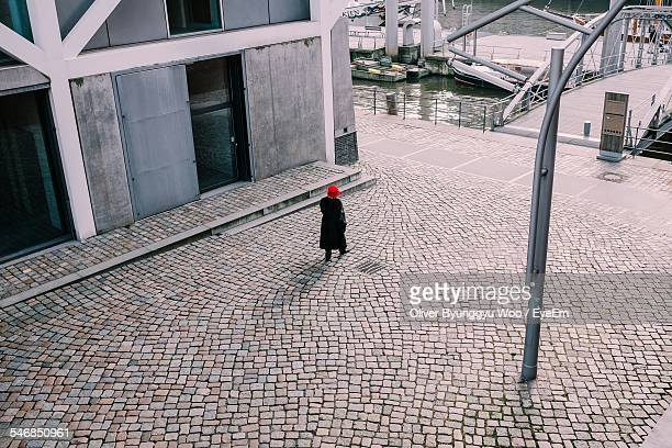 high angle view of person walking on cobblestone street - cobblestone stock pictures, royalty-free photos & images