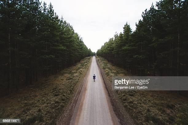 High Angle View Of Person Walking On Road