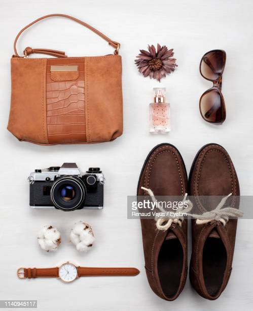 high angle view of personal accessories against white background - wrist watch stock pictures, royalty-free photos & images