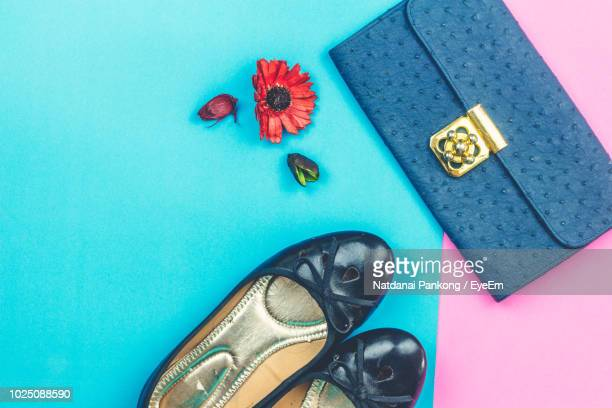 high angle view of personal accessories and flowers on table - pink purse stock pictures, royalty-free photos & images