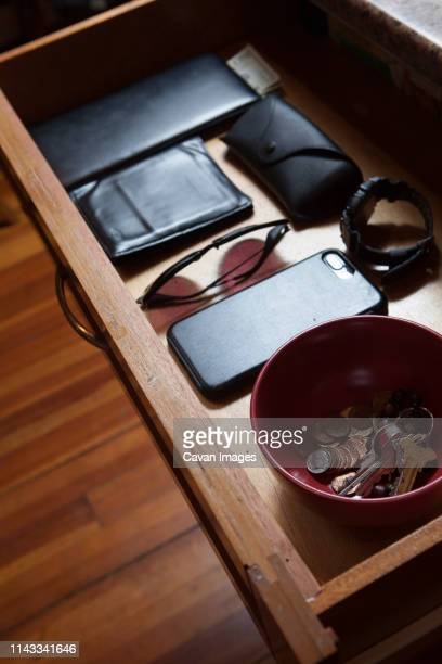 high angle view of personal accessories in drawer at home - drawer stock pictures, royalty-free photos & images