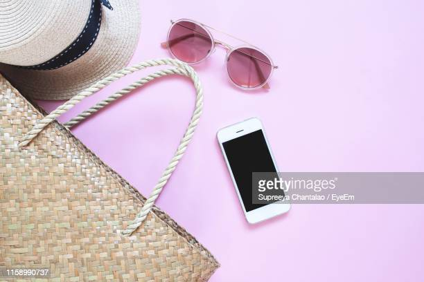 high angle view of personal accessories on pink background - pink purse stock pictures, royalty-free photos & images