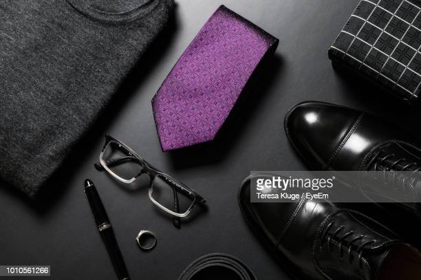 high angle view of personal accessories on table - sapato preto - fotografias e filmes do acervo