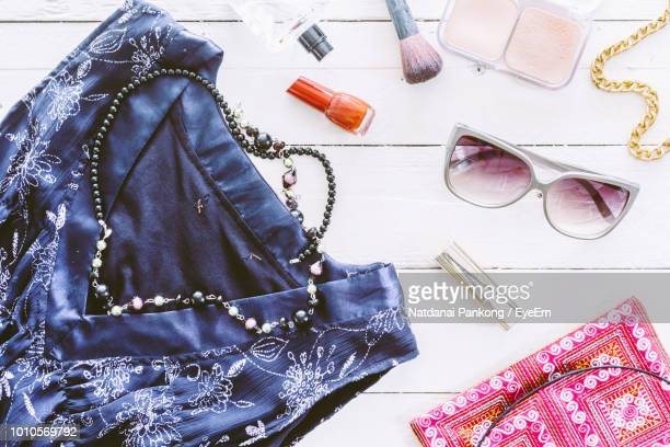 High Angle View Of Personal Accessories On Table