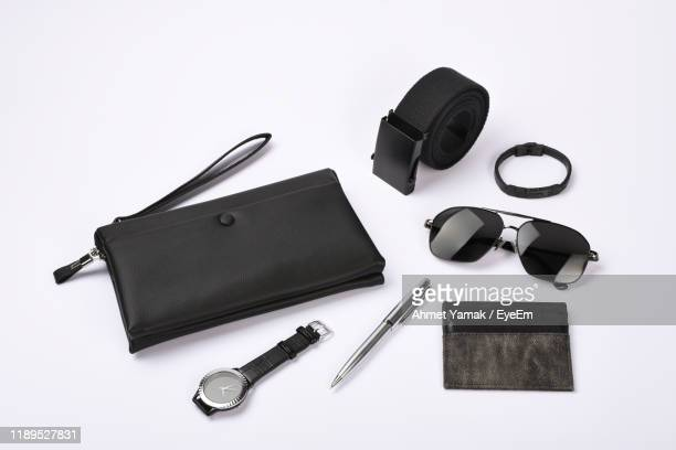 high angle view of personal accessories on white background - leather belt stock pictures, royalty-free photos & images