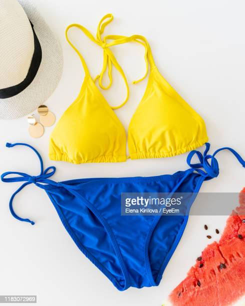 high angle view of personal accessories over white background - swimwear stock pictures, royalty-free photos & images