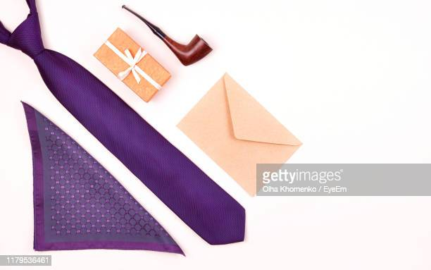 high angle view of personal accessories with gift and envelope on white background - handkerchief stock pictures, royalty-free photos & images