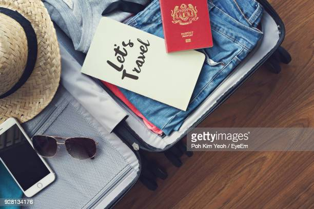 high angle view of personal accessories with travel bag on table - 準備 ストックフォトと画像