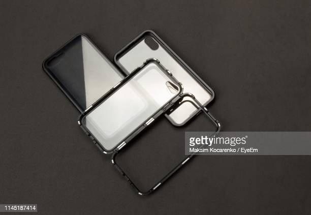 high angle view of phone cover on table - phone cover stock pictures, royalty-free photos & images