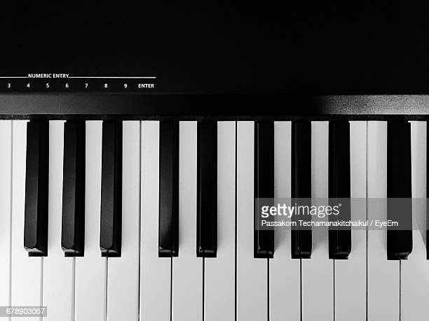 high angle view of piano keys - keyboard instrument stock photos and pictures