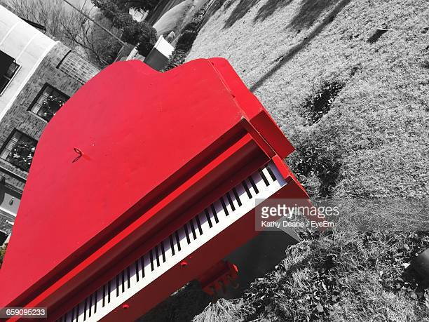 High Angle View Of Piano Made From Metal On Field