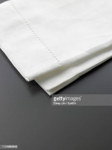 high angle view of piano on white background - paper napkin stock photos and pictures