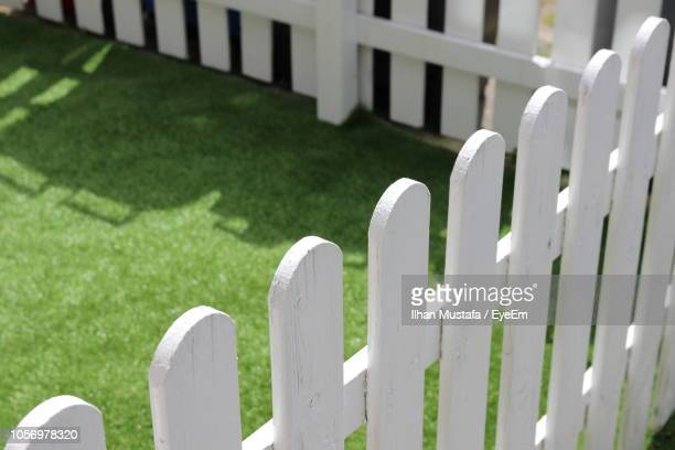 high angle view of picket fence in yard - fence stock pictures, royalty-free photos & images