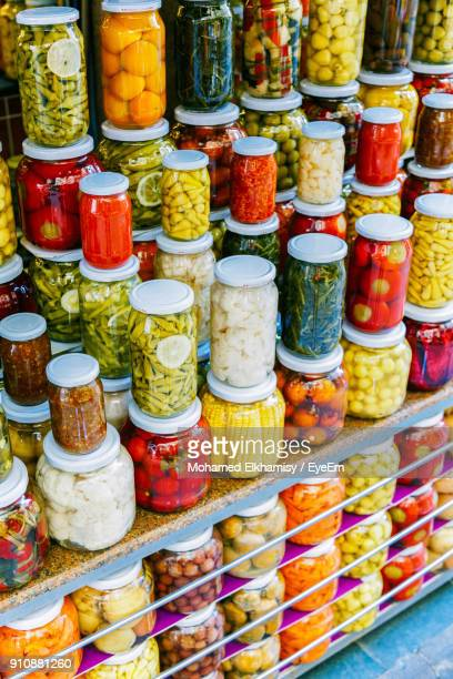 high angle view of pickled bottles for sale in market - pickled stock photos and pictures