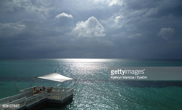 High Angle View Of Pier By Sea Against Cloudy Sky