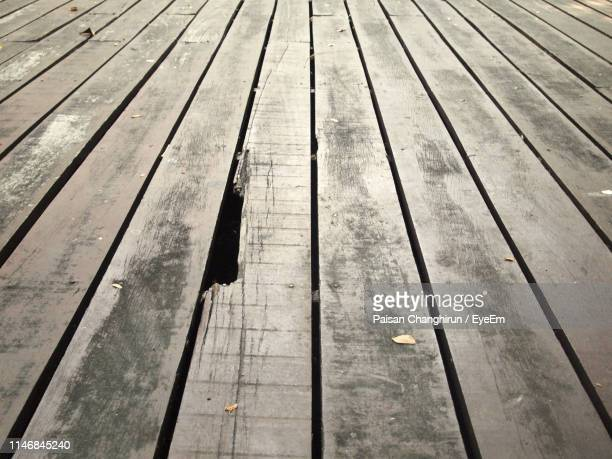high angle view of pier on footpath - floorboard stock photos and pictures