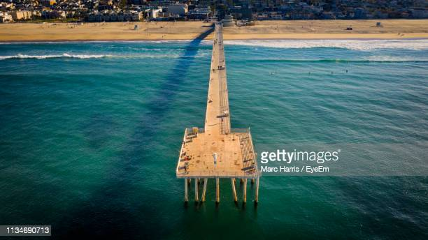 high angle view of pier over sea - hermosa beach stock pictures, royalty-free photos & images