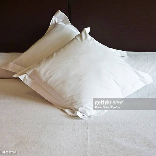 High Angle View Of Pillows On Bed