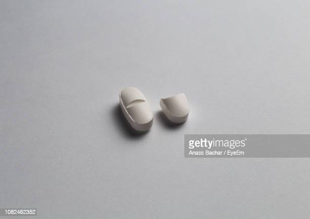 High Angle View Of Pills On White Background