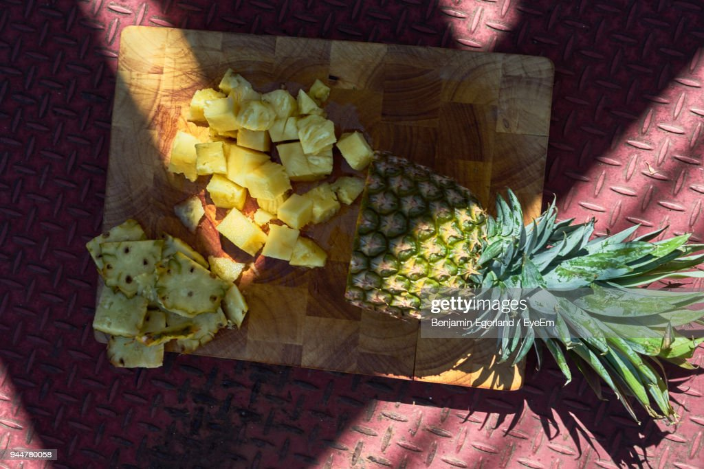 High Angle View Of Pineapple With Slice On Floor : Stock Photo
