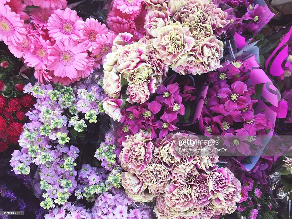 High Angle View Of Pink And Purple Flower Bouquets At Market Stock