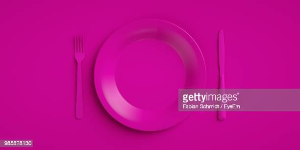 high angle view of pink eating utensils on table - eating utensil stock pictures, royalty-free photos & images