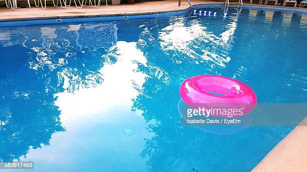 High Angle View Of Pink Inflatable Ring In Swimming Pool
