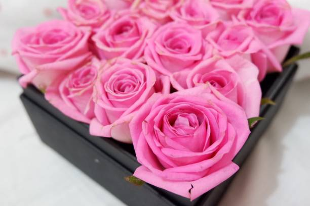 High Angle View Of Pink Roses In Box On Table