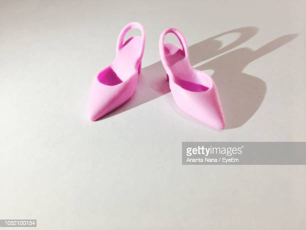 High Angle View Of Pink Shoes On Floor