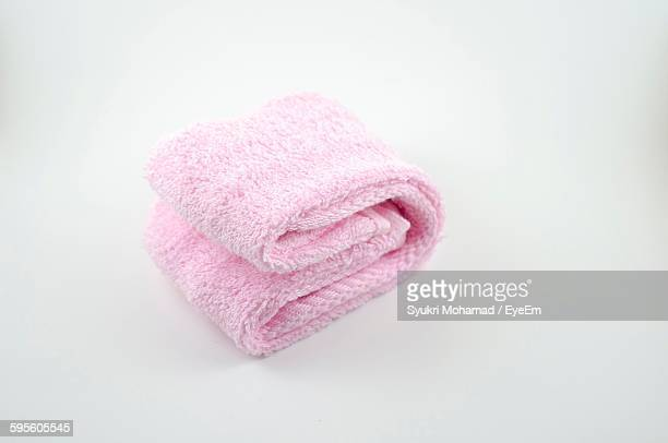 High Angle View Of Pink Towel Against White Background