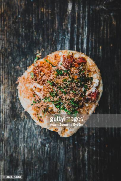 high angle view of pizza bread on table - truro cornwall stock pictures, royalty-free photos & images