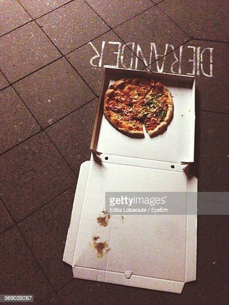 High Angle View Of Pizza In Box On Floor