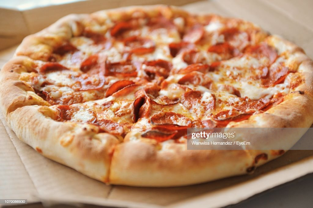 High Angle View Of Pizza On Table : Stock Photo