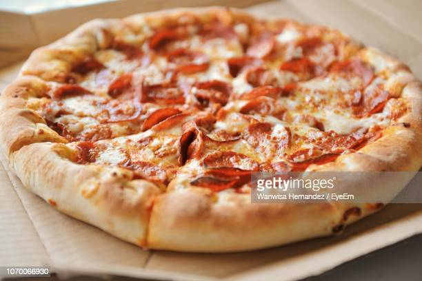 high angle view of pizza on table - pizza stock pictures, royalty-free photos & images
