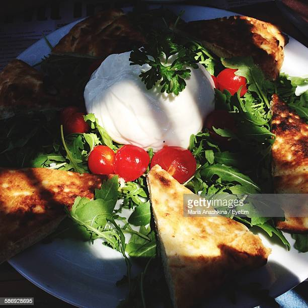 High Angle View Of Pizza With Burrata Cheese On Plate