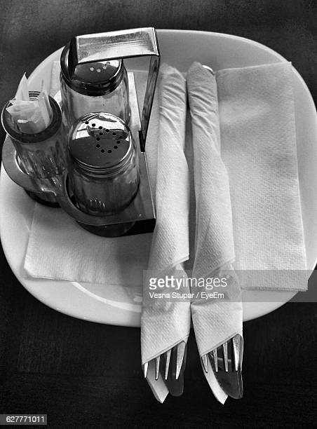 High Angle View Of Plate And Fork On Table