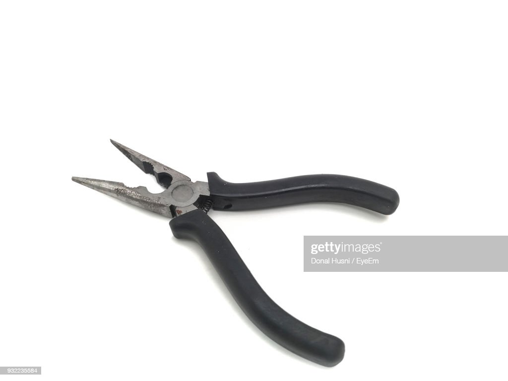 High Angle View Of Pliers Against White Background : Stock Photo