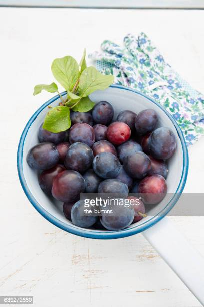 High angle view of plums in a colander