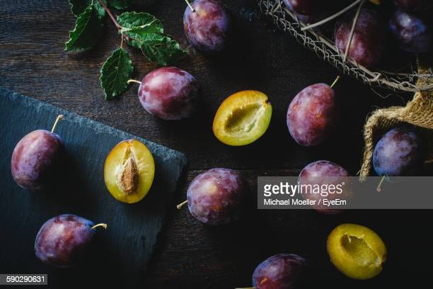 High Angle View Of Plums On Table