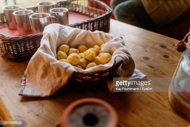 high angle view of pão de queijo on table - queijo ストックフォトと画像