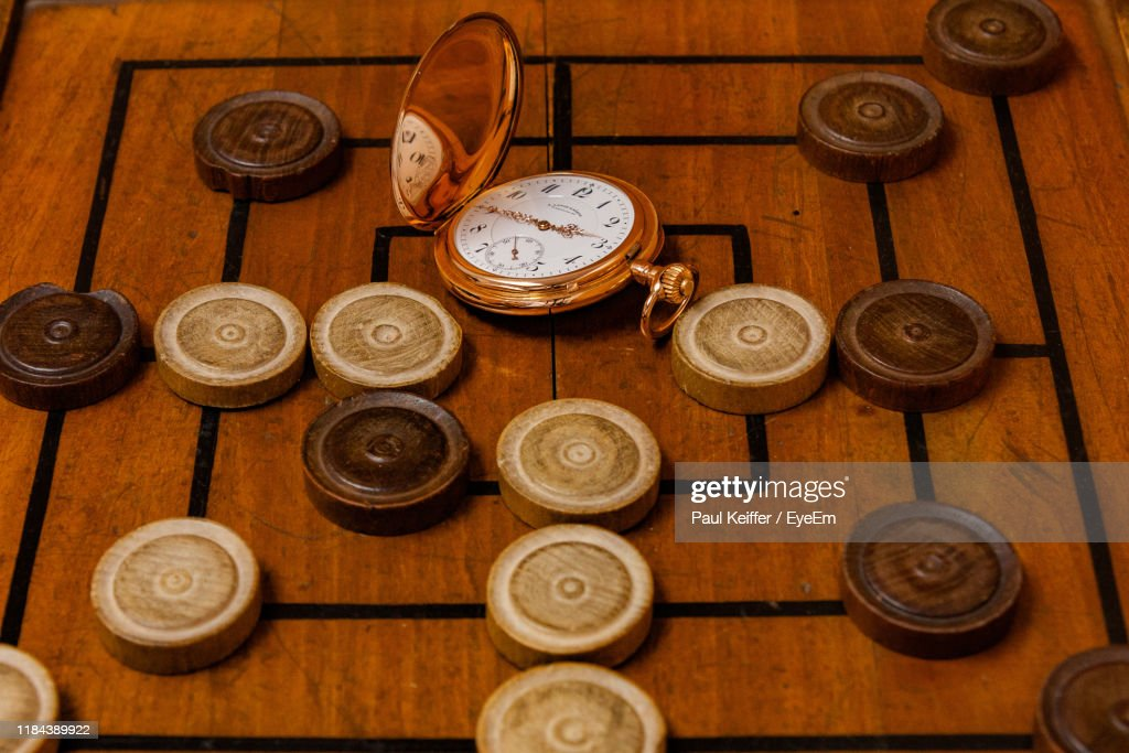 High Angle View Of Pocket Watch And Board Game : Stock Photo