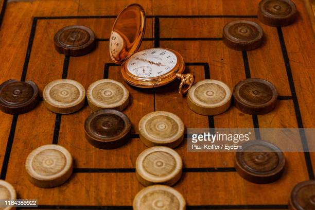 high angle view of pocket watch and board game - keiffer stock pictures, royalty-free photos & images