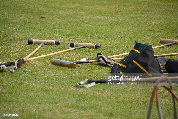 High Angle View Of Polo Mallets On Field